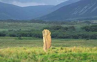 This 4.2m high stone pillar of reddish sandstone is a remnant of Stone Circle No.3